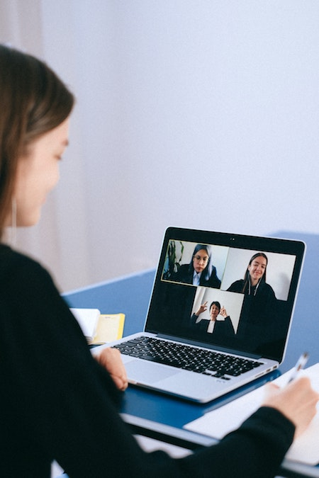 Image of woman participating in a zoom event on her laptop.